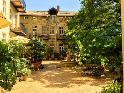 Apartment Hotel Berlin GARDEN LIVING - Innenhof und Garten